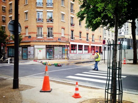 Parisian walks his plastic trucks on a quit Sunday afternoon